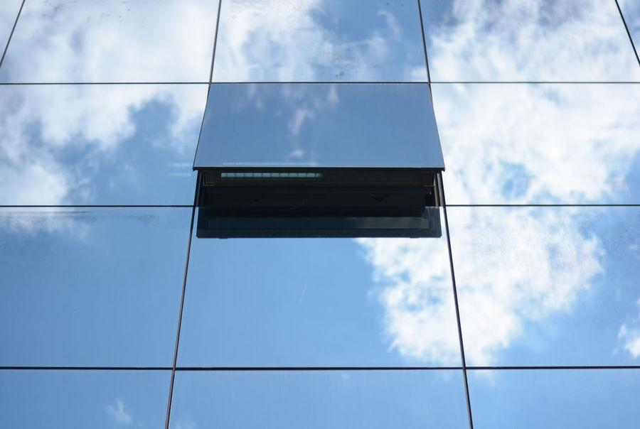 Window to the clouds. Adapted To The City Architecture Blue Blue Sky Building Exterior Built Structure Cloud - Sky Day Dreamy Glass Facades Glass Reflection Lines Nature No People Open Window Outdoors Sky Tower Windows The City Light The Graphic City Colour Your Horizn The Architect - 2018 EyeEm Awards #urbanana: The Urban Playground