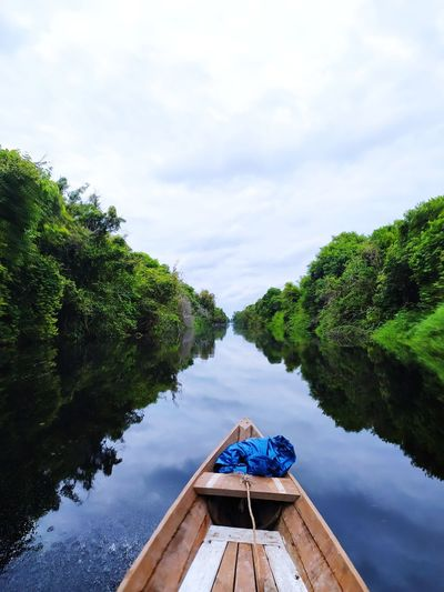 Scenic view of river and sky from boat