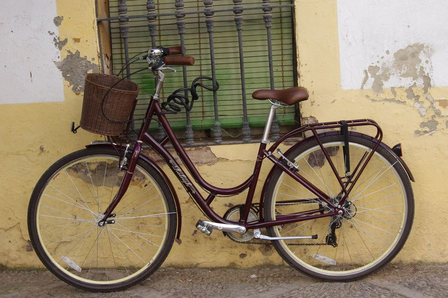 Classic Classic Bicycle Brown Restored Restoration Retro Ring Ring Bicycle Bell Old Fashion Rustic Rejas Sevilla SPAIN Andalucía EyeEm Best Shots Walking Around The City  Pentax Chained Up Raleigh Yellow Wall White Wall Window Old Old Buildings Basket
