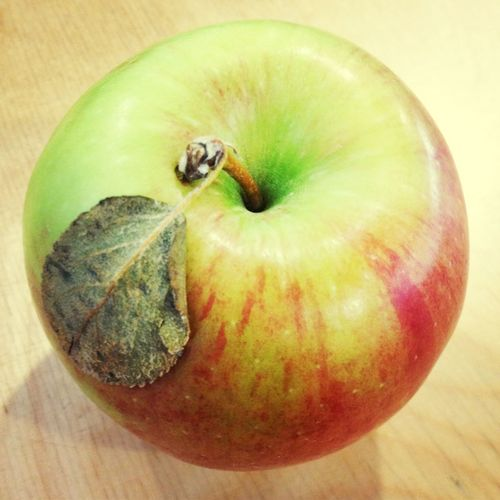 It's a real apple!! It has a leaf and is just soooo pretty!!