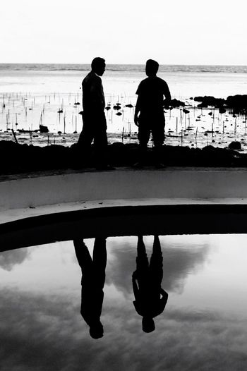 Double Lives Water Silhouette Sea Men Reflection Vacations Real People Beach Sunset Friendship conversations The Week On EyeEm EyeEmNewHere