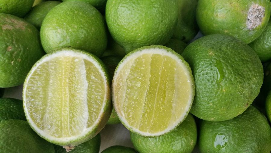Food And Drink Healthy Eating Freshness Fruit Lime Large Group Of Objects Green Color Abundance Citrus Fruit Full Frame Food Backgrounds No People Close-up Sour Taste Sweet Food SLICE Healthy Lifestyle Indoors  Day