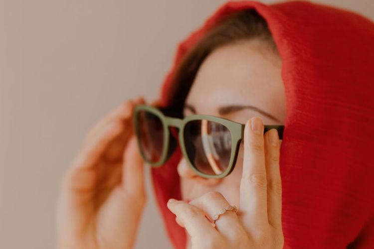 Close-up of human hand holding sunglasses