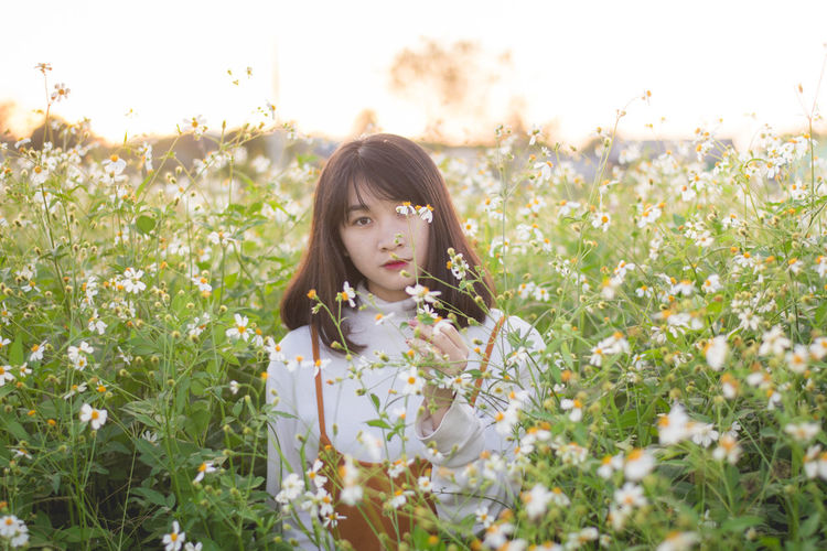 pretty girl Bangs Beautiful Woman Beauty In Nature Contemplation Day Field Flower Flowering Plant Grass Growth Hairstyle Land Leisure Activity Lifestyles Looking At Camera Nature One Person Outdoors Plant Portrait Real People Selective Focus Sky Women