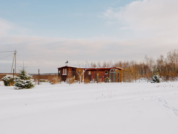 Winter Snow Cold Temperature Architecture Sky Built Structure Nature Building Exterior Field Day Land White Color No People Building Plant Beauty In Nature Outdoors Landscape Scenics - Nature