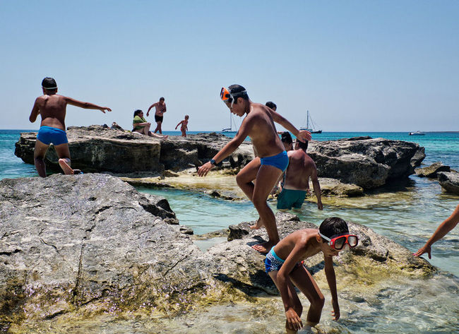 Rock'n roll Beach Bikini Clear Sky Day Enjoyment Italy Lifestyles Nature Outdoors Rock - Object Sea Shirtless Sky Summer The Street Photographer - 2017 EyeEm Awards Vacations Water