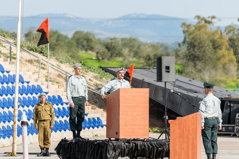 Mishmar David, Israel, Februar 21, 2018 : The officer of the IDF makes a speech on the podium at the formation in Engineering Corps Fallen Memorial Monument in Mishmar David, Israel Engineering Corps Fallen Memorial Monument Event Formation Officer Patriotism Soldier Soldiers Standing Uniform Warrior Armed Army Ceremony Combat Day Education Idf Infantry Israel Military Parade People person Professional Training