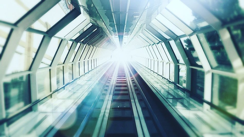 Indoors  Built Structure The Way Forward Railroad Track No People Architecture Lens Flare Lights The Street Photographer - 2017 EyeEm Awards Geometry Everywhere Reflections Glass The Architect - 2017 EyeEm Awards EyeEmNewHere Illuminated Symmetry Transportation Rail Transportation Subway Train