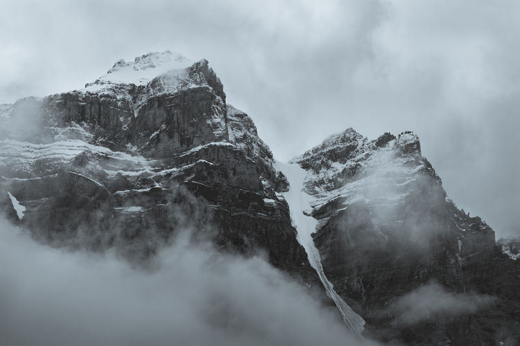 Mighty black and white Top of the mountains, snow covered & foggy, Moraine Lake, Banff National Park, Alberta, Canada. Nature Black&white Black And White Snowcapped Mountain Mountain Peak Formation Outdoors Idyllic Geology Winter Rock Day Environment No People Mountain Range Tranquility Cold Temperature Nature Fog Sky Tranquil Scene Non-urban Scene Scenics - Nature Cloud - Sky Mountain Beauty In Nature Snow 17.62° Stay Out