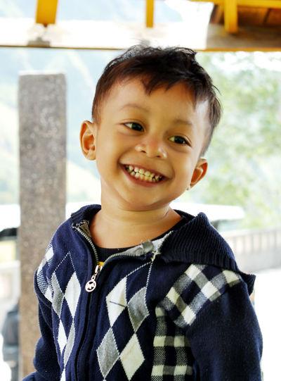 Smiling boy standing indoors