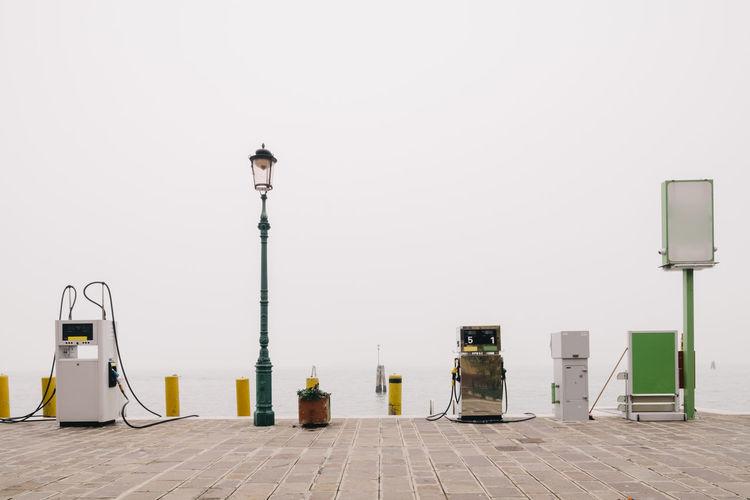 Gasoline on promenade against sky