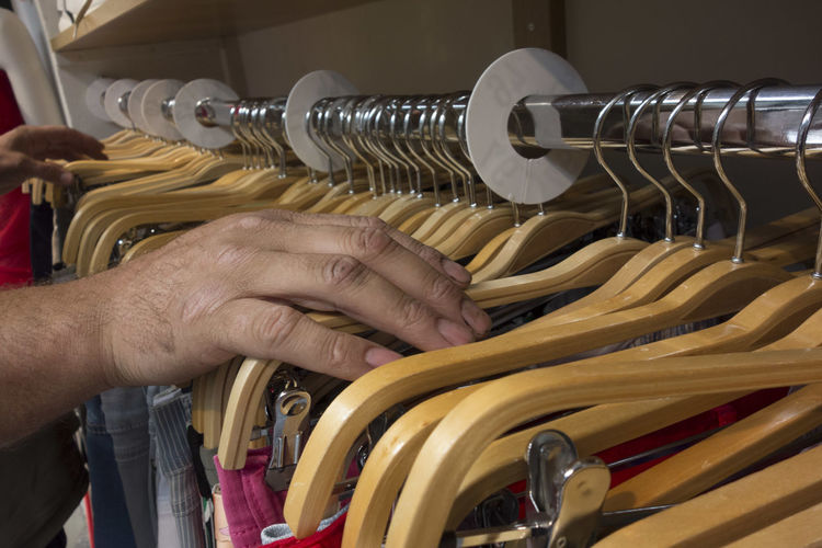 Close-up of man working in rack
