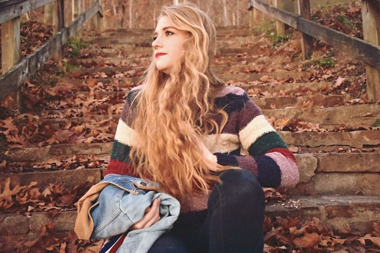 Autumn Young Adult Sitting One Person Leaf Young Women Blond Hair Long Hair Beautiful Woman Adult Women Lifestyles Only Women One Young Woman Only One Woman Only Human Body Part Beautiful People Outdoors Day Beauty