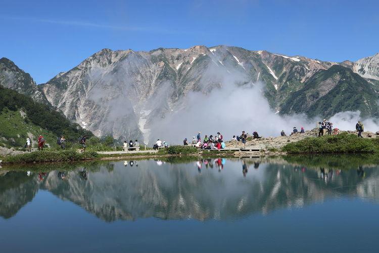 People by lake