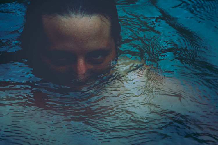 Striking portraiture of half submerged male face