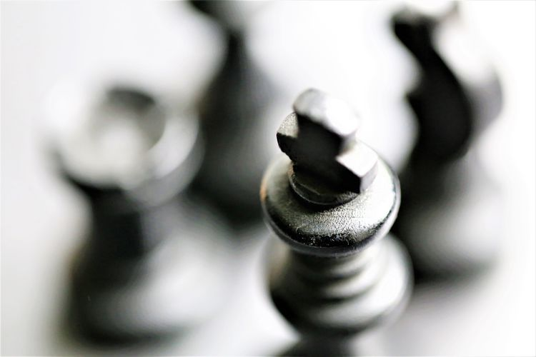 Chess Piece Indoors  Still Life Close-up No People Chess Leisure Games Game Board Game Leisure Activity Relaxation Extreme Close-up White Color High Angle View Metal Selective Focus Focus On Foreground Old Day