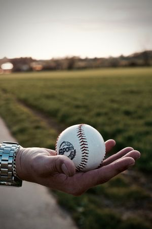 Ball Baseball - Ball Baseball - Sport Baseball Pitcher Close-up Day Field Focus On Foreground Grass Holding Human Body Part Human Hand Men Nature One Person Outdoors People Personal Perspective Real People Sky Sport Sportsman