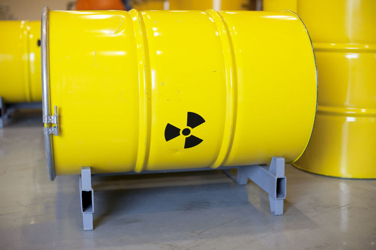 Close-up of radioactive barrels