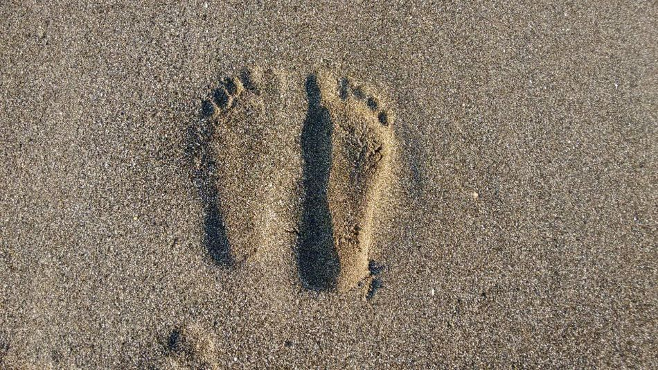 Foot prints looks high above the sand. How this happens? Beach Beaches Directly Above Footprints Geometry High Angle View Ideas Sand Shadow Textured