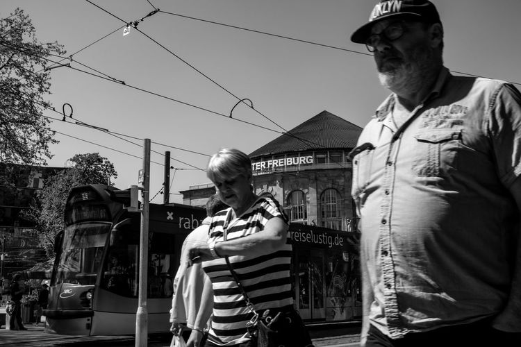 Come on! We're late ... Urban Perspectives Street Photography Black & White Walking Around City Streetphoto_bw Black And White Monochrome The Devil's In The Detail Real People Casual Clothing Standing Lifestyles Men Sky Waist Up Architecture People Building Exterior Incidental People Front View Leisure Activity Street Built Structure Day The Street Photographer - 2019 EyeEm Awards