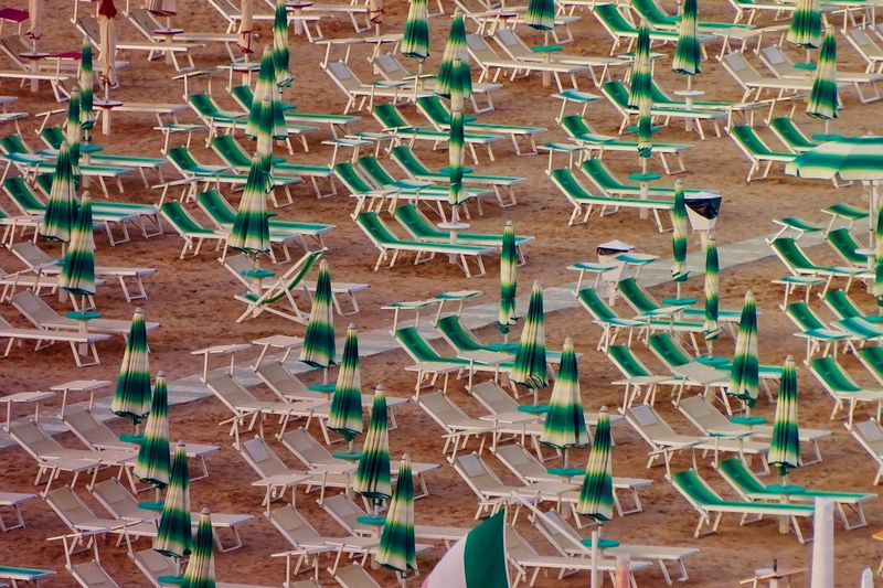 Beach Life Beach Umbrella High Angle View Full Frame Backgrounds No People Day Land Large Group Of Objects Abundance In A Row Arrangement Side By Side Pattern Green Color Repetition Holiday Outdoors Nature Sunlight Architecture