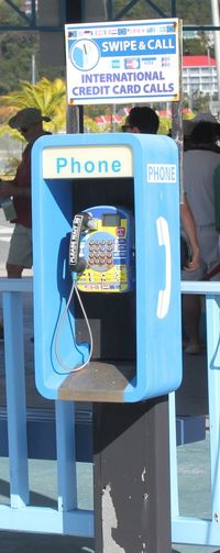 Public Telephone in Road Town on Tortola Blue Blue Telephone Blue Telephone Box Close-up Communication Day No People Outdoors Phone Public Phone Public Phone Public Phone Booth Public Phone Box Public Telephone Sunlight Text