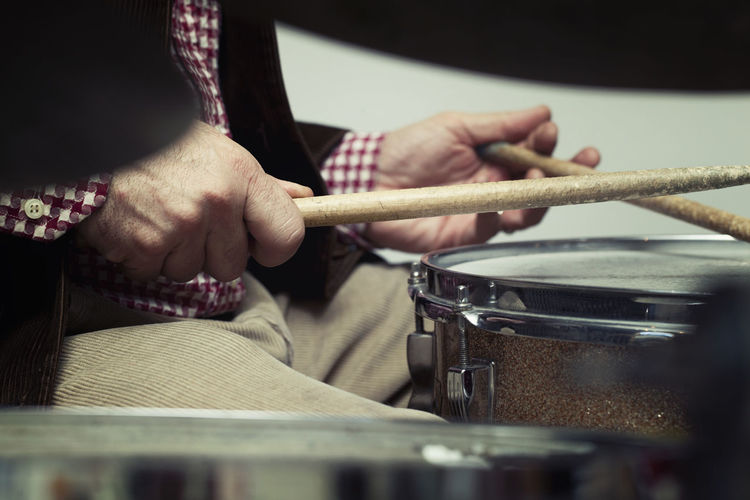 Midsection Of Musician Playing Drums