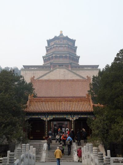 Group of people in temple against building