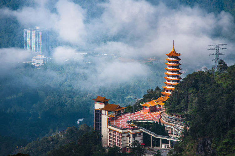 Aerial view of buddhist temple in a forest located in genting highland, malaysia