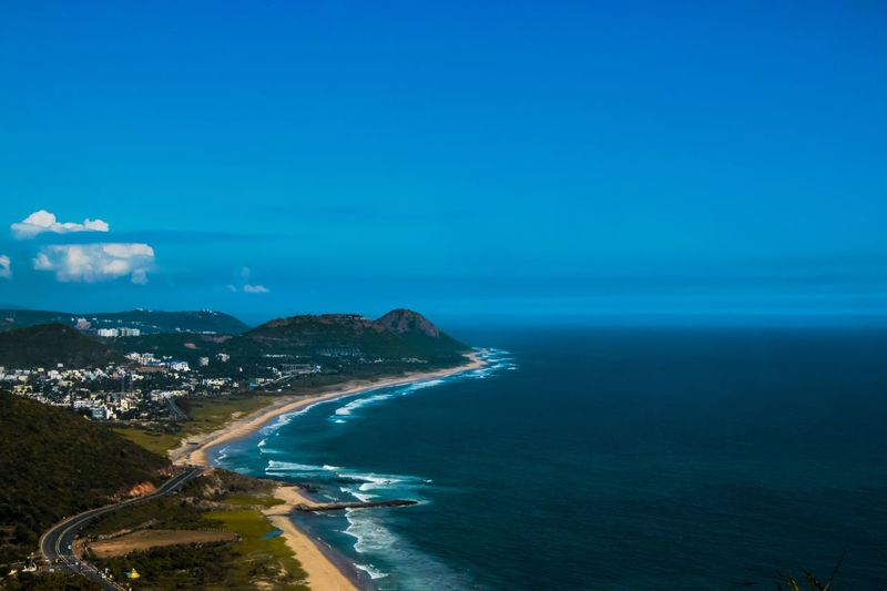The Vizag marine drive Marine Drive Sea Beach Water Horizon Over Water Scenics Beauty In Nature Go Higher No People Mountain Clear Sky Sky Outdoors Blue Day Nature The Great Outdoors - 2018 EyeEm Awards The Traveler - 2018 EyeEm Awards Summer Road Tripping