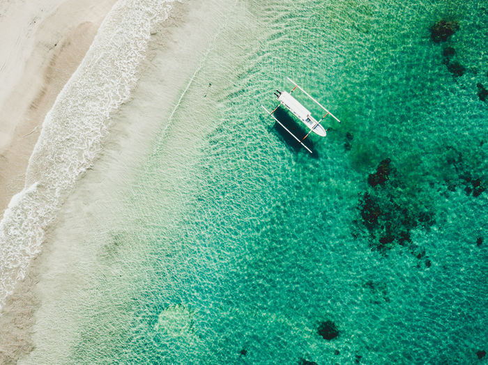 Aerial View Aquatic Sport Beach Beachfront Beauty In Nature Clear Water Day High Angle View Land Luxury Motion Nature Nautical Vessel No People Outdoors Reef Scenics - Nature Sea Sport Swimming Pool Tranquil Scene Tranquility Turquoise Colored View From Above Water