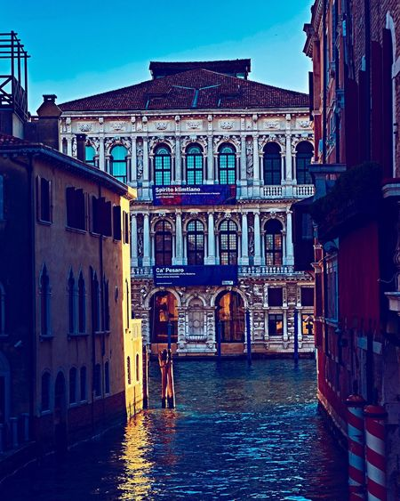 Architecture Building Exterior Built Structure Cultures Real People Travel Destinations Outdoors Men Sky Gondola - Traditional Boat Day People