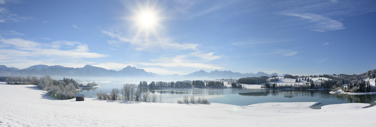 Scenic view of snowcapped lake against sky during winter