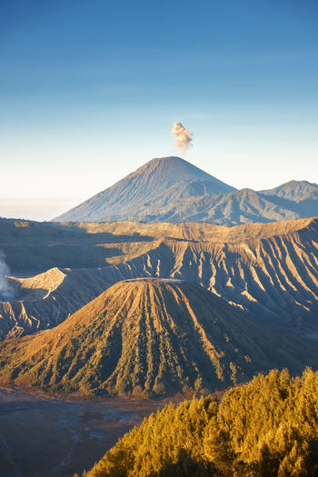 Beautiful sunrise scenery at Mount Bromo, Indonesia Arid Climate Beauty In Nature Bromo Day Environment Geology Idyllic Land Landscape Mountain Mountain Peak Mountain Range Nature No People Non-urban Scene Outdoors Physical Geography Scenics - Nature Sky Snowcapped Mountain Sunlight Tranquil Scene Tranquility Travel Destinations Volcano