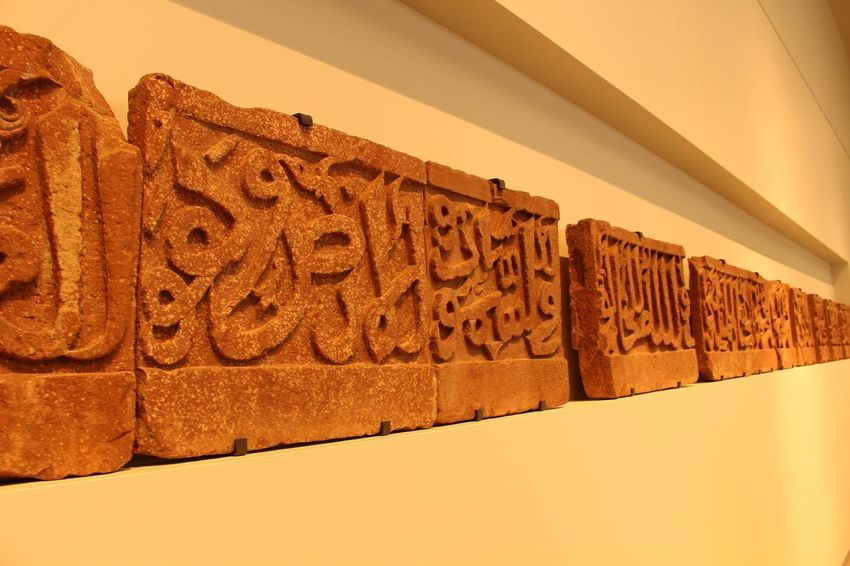Arabic writings ,louvre museum Abu dhabi Arabic Script Louvre Museum In Abu Dhabi Text No People Communication Wall - Building Feature Indoors  Architecture Pattern Wall Brown Close-up Art And Craft Creativity Message The Past