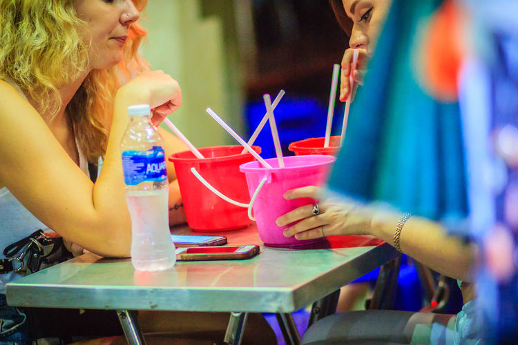 Bangkok, Thailand - March 2, 2017: Tourists are drinking cocktail on bucket mug liter and having drunk fun at travel vacation at Khao San Road in Bangkok, Thailand. Cocktail Cocktail Time Khao San Rd Khao San Road KhaoSan Khaosan Rd. Khaosandroad Cocktail Bar Khao San Khao San Knok Wua Khao San Rd. Khaosan Road Khaosanroad Night Market Soft Drink Soft Drinks