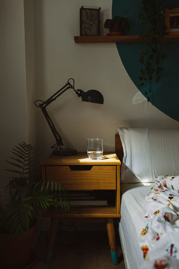 Table and chairs on bed at home