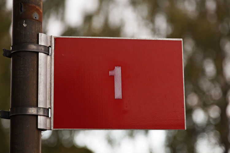 The number one on a red sign with white text