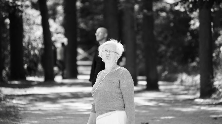 Senior Woman Standing In Park