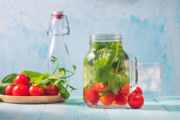 Detox water with vegetables and fruits. Diet healthy eating and weight loss. Detox Bottle Container Focus On Foreground Food Food And Drink Freshness Fruit Glass - Material Healthy Eating Herb Indoors  Jar Mint Leaf - Culinary No People Red Ripe Still Life Table Tomato Transparent Vegetable Wellbeing