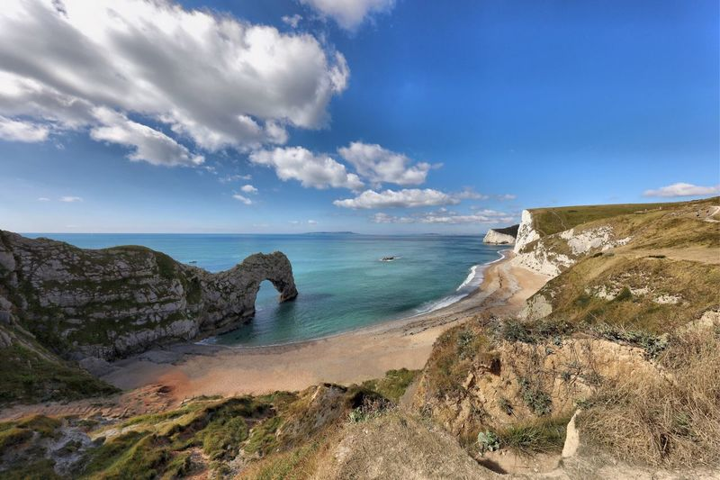 Dorset Sea Horizon Over Water Water Scenics Tranquil Scene Sky Beauty In Nature Tranquility Rock Formation Rock - Object Cliff Idyllic Travel Destinations Nature Non-urban Scene Tourism Blue Majestic Cloud - Sky Geology