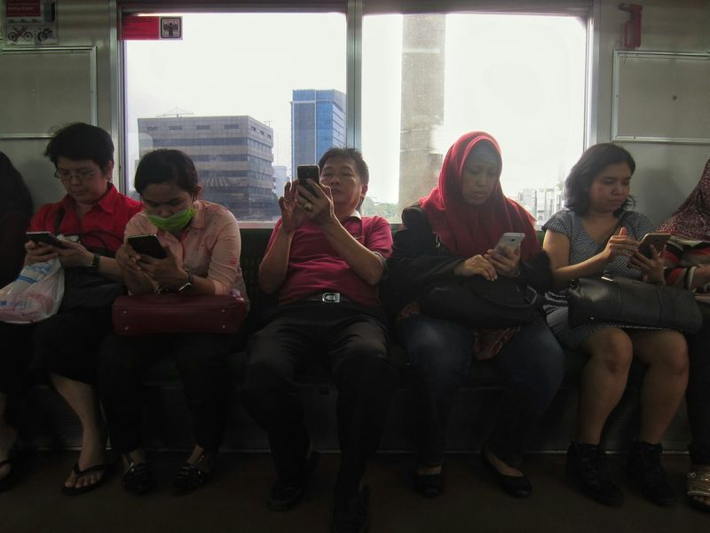 Medium Group Of People Full Length People Commuting Commuting Ride Commuting Life Train Interior Commute To Work City Life Real Life Authenticity Commuter Line Commuter Train Working People Urban Scene Urban Lifestyle People And Technology Technology Using Mobile Phone Using Phone Phone South East Asia at Jakarta INDONESIA Mobile Conversations