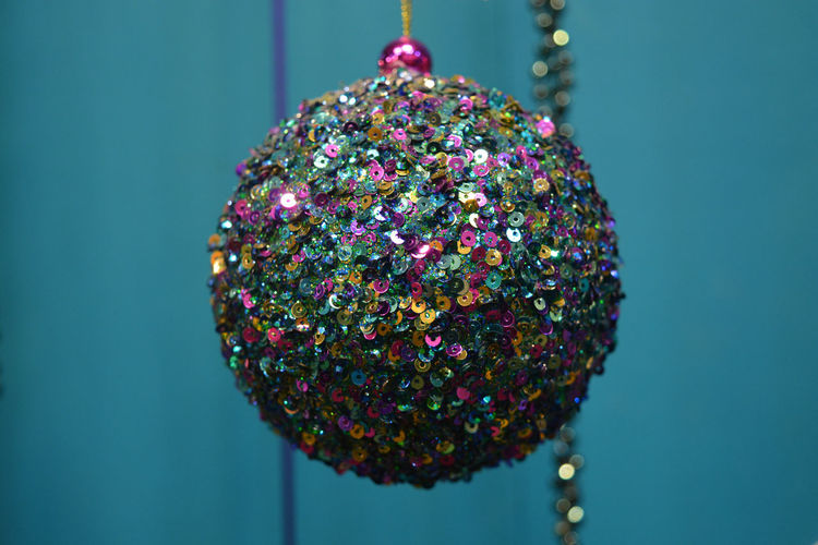 Christmas bauble, decorated with multi coloured sequins Celebration Christmas Christmas Bauble Christmas Decoration Christmas Lights Christmas Ornament Christmas Tree Close-up Colourful Day Indoors  Multi Colored Multicolors  No People Round Sequins Sphere Spherical