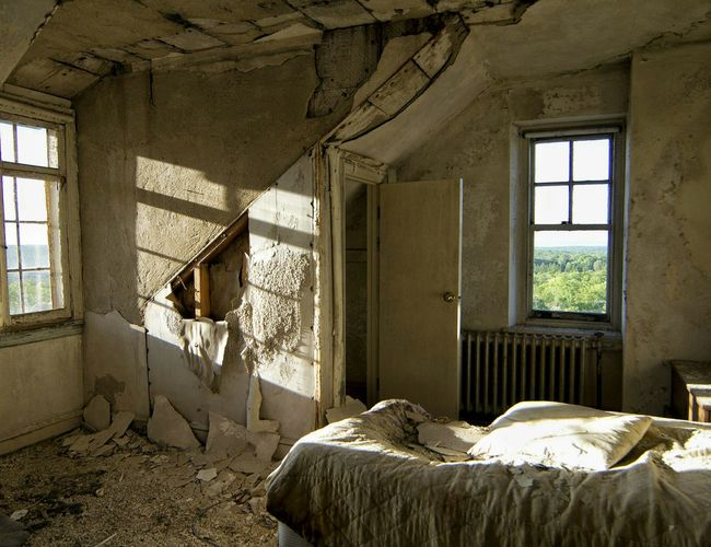 Abandoned interior with peeled wall and windows