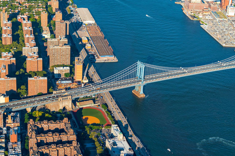 High angle view of bridge over river against buildings