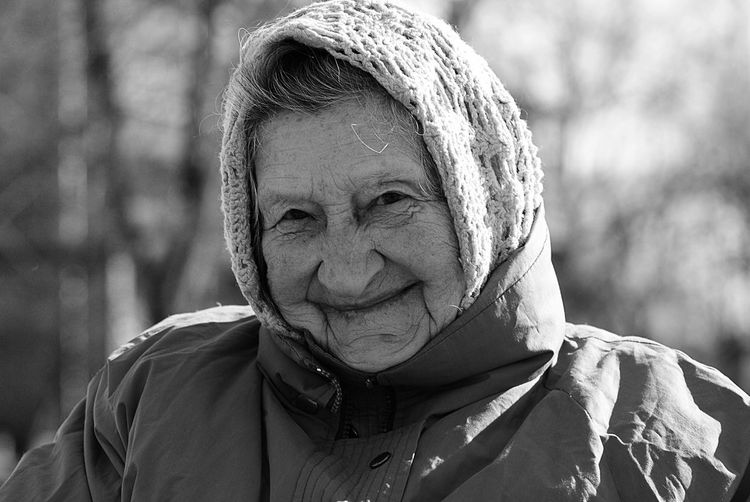 Authentic Moments Black And White Close-up Focus On Foreground Headshot Lifestyles Looking At Camera Old Woman One Person Outdoors People Portrait Real Life Real People Senior Senior Adult Senior Women Warm Clothing Wrinkled The Portraitist - 2017 EyeEm Awards