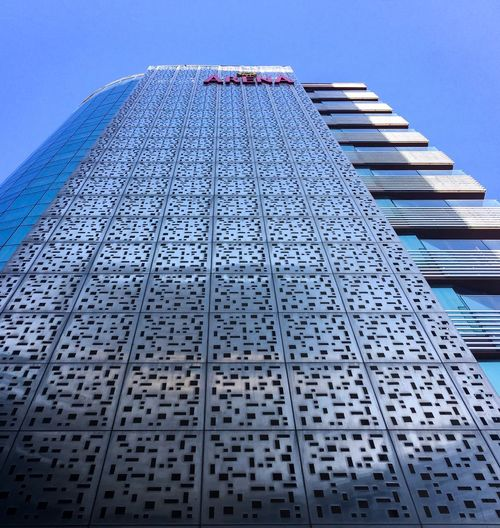 Arena Built Structure Architecture Low Angle View Sky Building Exterior No People Holiday Moments Pattern Blue Nature Tall - High Outdoors Building City Office Building Exterior Day Modern Metal Staircase Clear Sky Design
