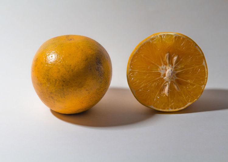 Close-up of orange on white background