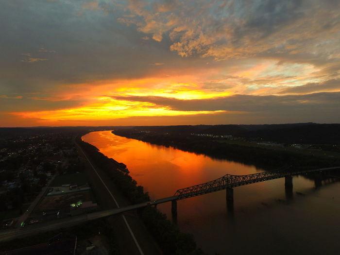 High Angle View Of Robert C Byrd Bridge Over Ohio River Against Orange Sky