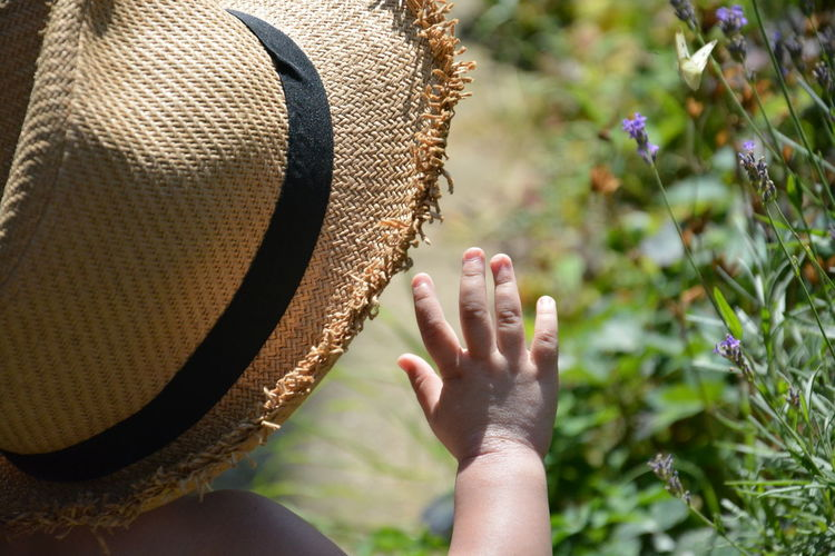 Close-up of girls wearing hat by plants